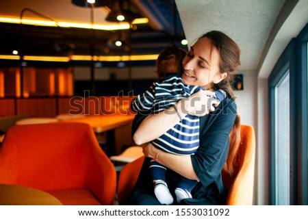 Mothers day concept. woman smile mother cuddling her innocent baby boy . #1553031092