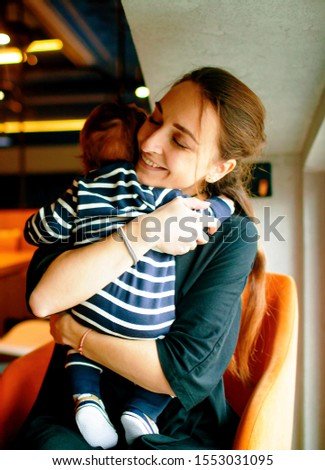 Mothers day concept. woman smile mother cuddling her innocent baby boy . #1553031095