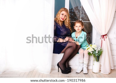 Mothers day holiday concept. mother and little daughter with flowers