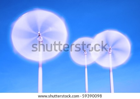 motion blade of modern win turbine in windy day with blue sky.
