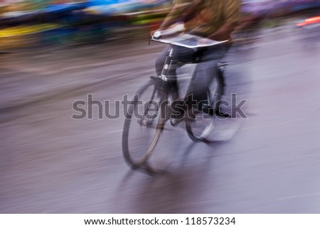 motion blur abstract of a bike rider in the street