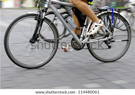 Motion blur abstract of a bike rider on the street