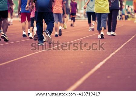 Motion blur group of people Walking exercise. #413719417