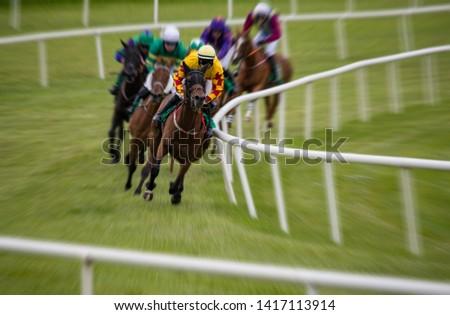 Motion blur horse racing action, speeding motion blur zoom effect #1417113914
