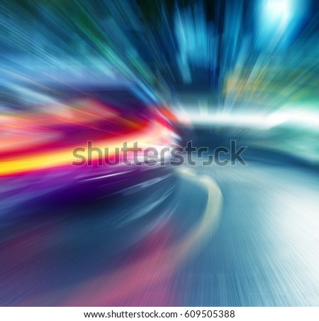 Motion blur lights of rushing car in the night city.Bokeh background. Defocused background #609505388