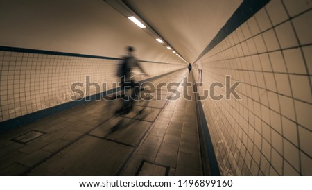 Motion blur of a cyclist crossing the Saint-Anna Tunnel in Antwerp (Belgium) #1496899160