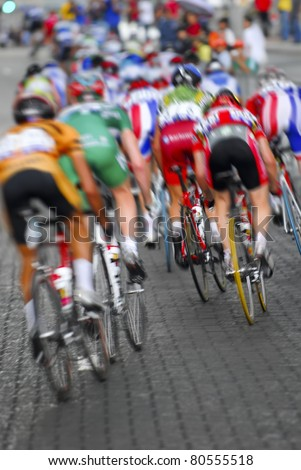 Motion blur of a group of cyclists in action during a cycling tour.
