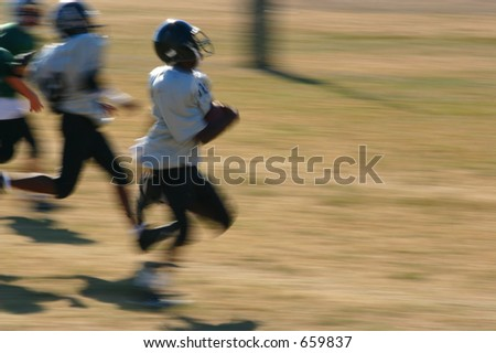 motion blur of boy running in for the touchdown