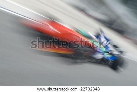 Motion blur of sports car at motorsports championship race.