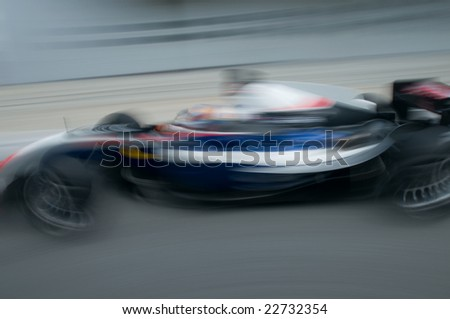 Motion blur of sports car at motorsports championship race.
