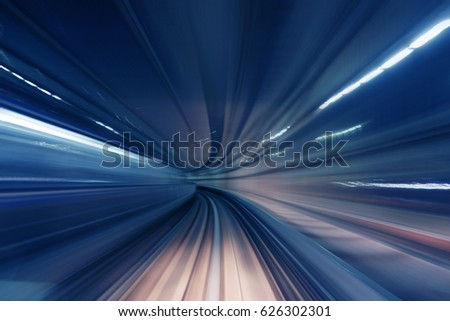 Motion blur of train moving in tunnel #626302301