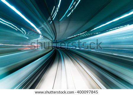 Motion blur of train moving inside tunnel  #400097845