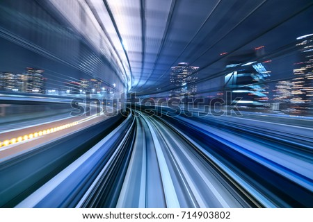 Motion blur of train moving inside tunnel in Tokyo, Japan #714903802