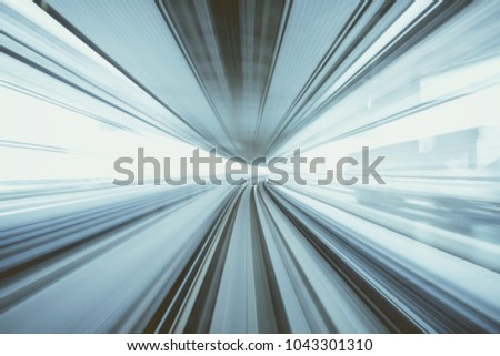 Motion blur of train moving inside tunnel with daylight in tokyo, Japan, gray color vintage tone