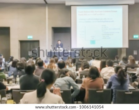 Motion blur of view of seminar with audience in a seminar room #1006141054