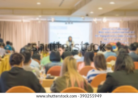 Motion blur of view of seminar with audience in a seminar room #390255949
