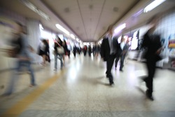 Motion blur of walking people. People on the way to work, rushing through the underground tunnel. Seoul, South Korea