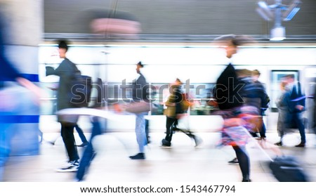 Motion blur of walking people. People on the way to work, rushing through the underground tunnel. London, UK #1543467794