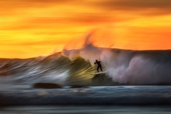 Motion Blur photo of a surfer riding  on a large wave at Bronte Beach, Sydney Australia