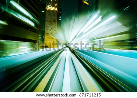 Motion blur train moving in city rail tunnel. Motion blur background abstract. #671711215