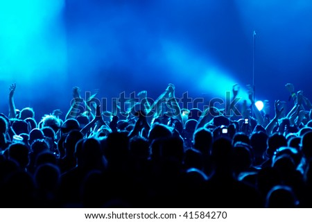 Motion Blur version of clapping hands/cheering crowd at concert #41584270