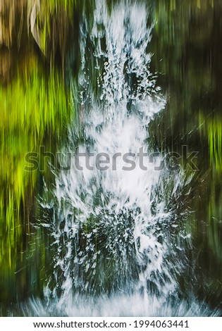 Motion blur. Waterfall in the mountains. Water splashes. Long exposure, selective focus. Stock fotó ©