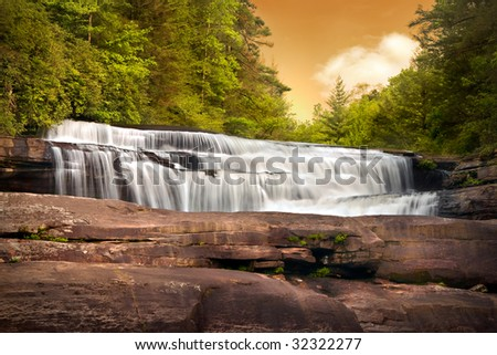 Motion Blur Waterfalls Nature Landscape in Blue Ridge Mountains Sunset with green trees, rusty rocks and flowing water