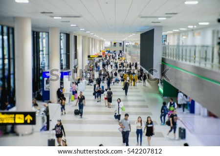 Motion blurred background : People walking in the airport