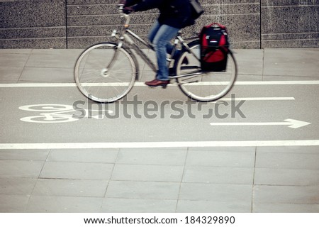 Motion blurred bicycle in profile