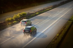 Motion blurred cars on the highway. Road safety concept.