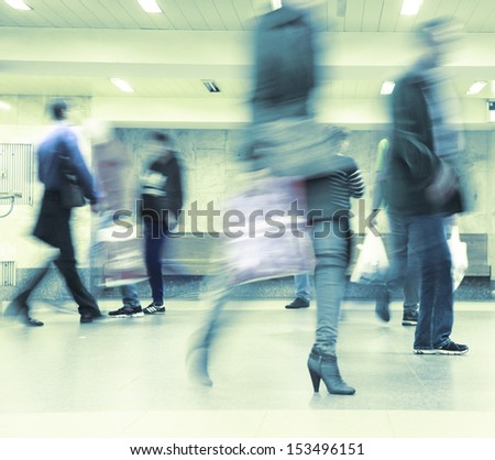 Motion blurred commuters walking in subway station. #153496151