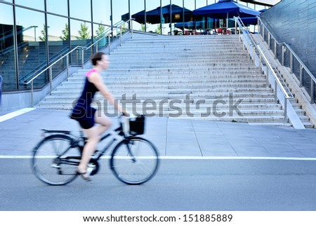 Motion blurred female bicyclist in city