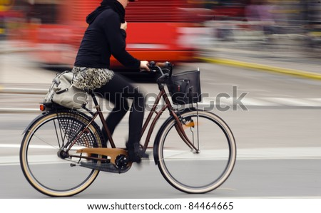 Motion blurred female biker