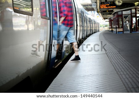 Motion blurred man entering train