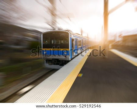 Motion blurred of high speed train on sunny day