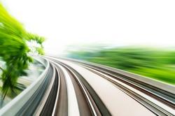 Motion blurred on speeding sky train.