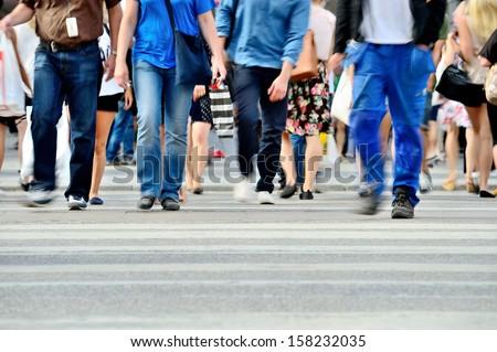 Motion blurred pedestrians crossing sunlit street #158232035