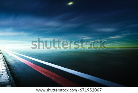Motion blurred race track,cold  mood . #671952067