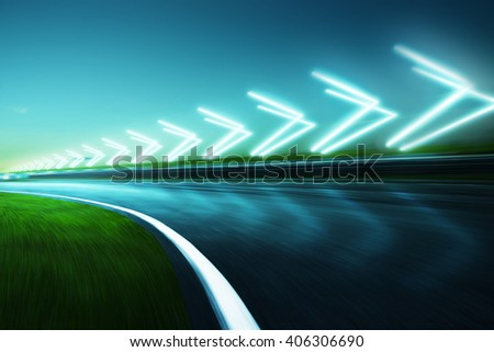 Motion blurred racetrack,night scene cold mood. with arrow light Effects.