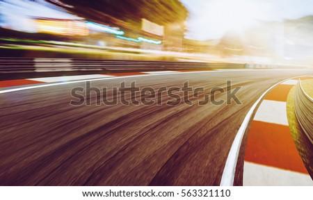 motion blurred racetrack sunset ...