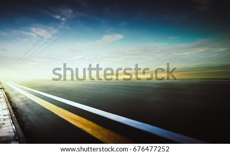 Motion blurred racetrack,warm mood #676477252