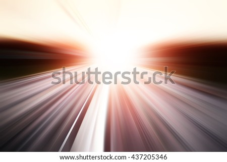 Motion blurred road during sunset. #437205346