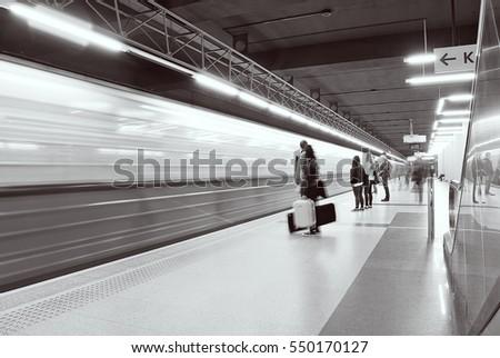 Motion blurred subway train. black and white.