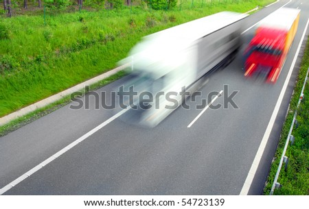 Motion blurred truck on highway.