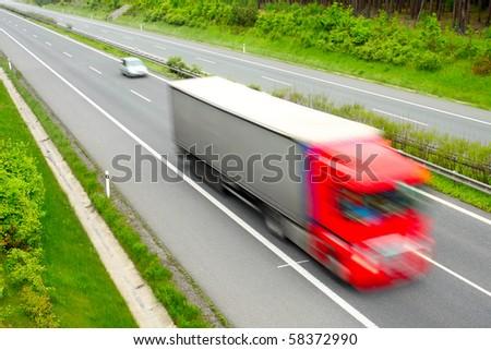 Motion blurred truck on highway. Transportation industry metaphor