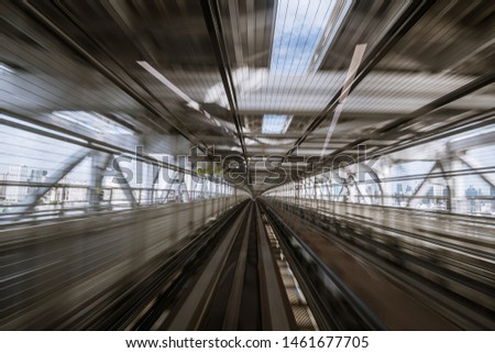 """motion-blurred view from a moving train running in tunnel. The Japanese means """"alerts, diversions"""" #1461677705"""