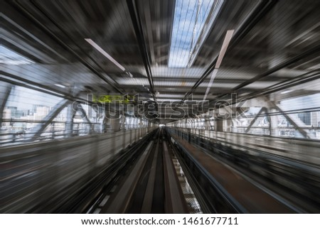 """motion-blurred view from a moving train running in tunnel. The Japanese means """"alerts, diversions"""" #1461677711"""