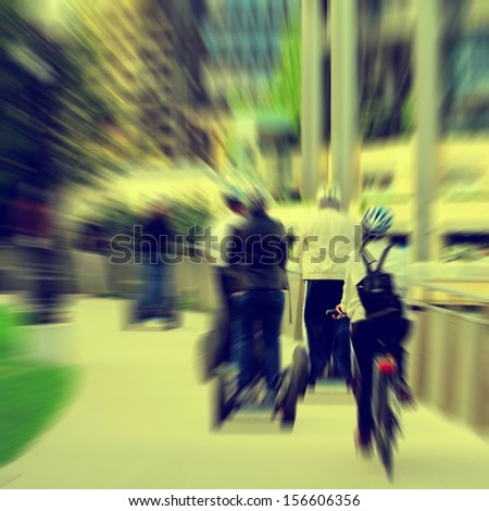 Motion blurred with several people moving over a modern omnidirectional personal transport platform