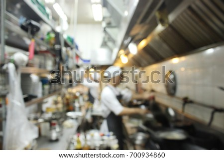 Restaurant Kitchen Background free chefs cooking of a restaurant kitchen,motion blur background