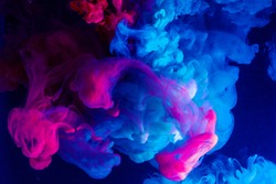 Motion Color drop in water,Ink swirling in ,Colorful ink abstraction.Fancy Dream Cloud of ink under water